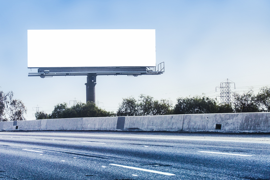 Big white billboard on empty high way ** Note: Visible grain at 100%, best at smaller sizes